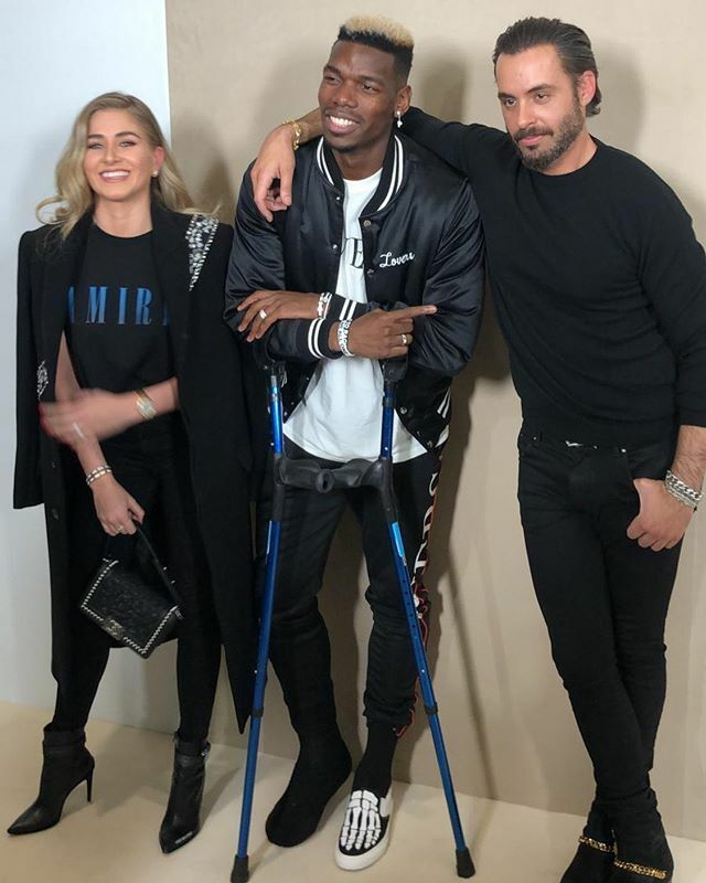 Pogba and partner Zulay posed with fashion designer Amiri while holding crutches